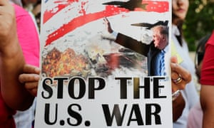 """Placard  reads """"stop the US war"""""""