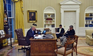 Donald Trump in the Oval Office with Bannon and Michael Flynn, who resigned as national security adviser in February over his ties to Russia.