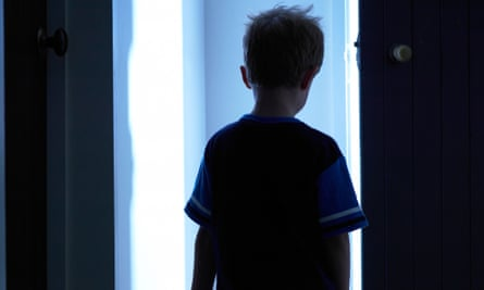 child walking in house at night