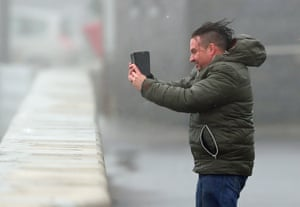 "Autumn weather Oct 16th 2017A man take selfies in waves and high wind at Lahinch in County Clare on the West Coast of Ireland as Hurricane Ophelia hits the UK and Ireland with gusts of up to 80mph. PRESS ASSOCIATION Photo. Picture date: Monday October 16, 2017. The tropical storm has made its way across the Atlantic and Ophelia's remnants reached home shores on Monday, resulting in ""exceptional"" weather - exactly 30 years after the Great Storm of 1987 killed 18 people. See PA story WEATHER Ophelia. Photo credit should read: Niall Carson/PA Wire"