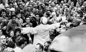 Pope Pius XII addresses a crowd in Rome in 1943 after a US bombing raid.