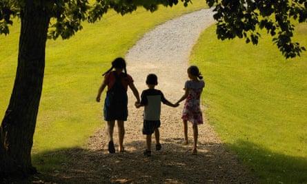 Three children hand in hand