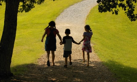 Three children walking on a path.