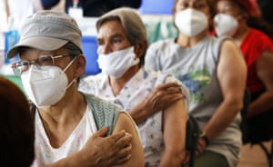 Persons over 60-years-old wait in observation after receiving their second dose of the AstraZeneca Covid-19 vaccine at the University Olympic Stadium in Mexico City.