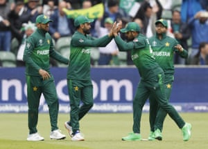 Hafeez, second left celebrates after taking a catch to dismiss Finch.