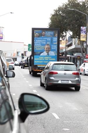 Tony Abbott signage joins the traffic jam.