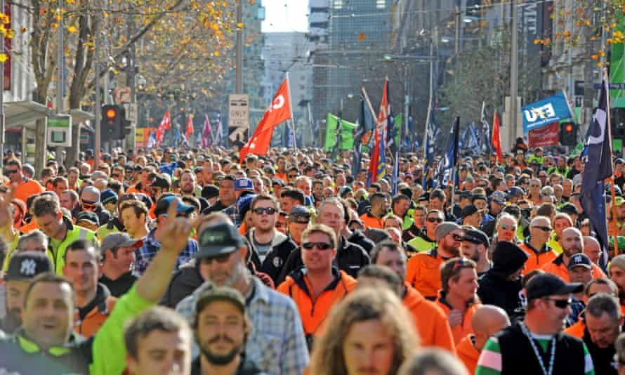 Building and construction workers march during a rally in Melbourne, Tuesday, June 20, 2017. The CFMEU is rallying against the federal government's reintroduction of the Australian Building and Construction Commission, changes to the Building Code, possible cuts to penalty rates and attacks on workers' rights.