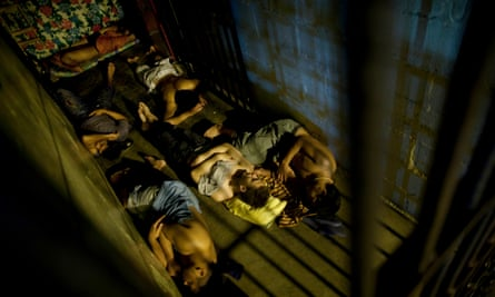 Inmates sleep inside their cell in San Pedro Sula central corrections facility, Honduras