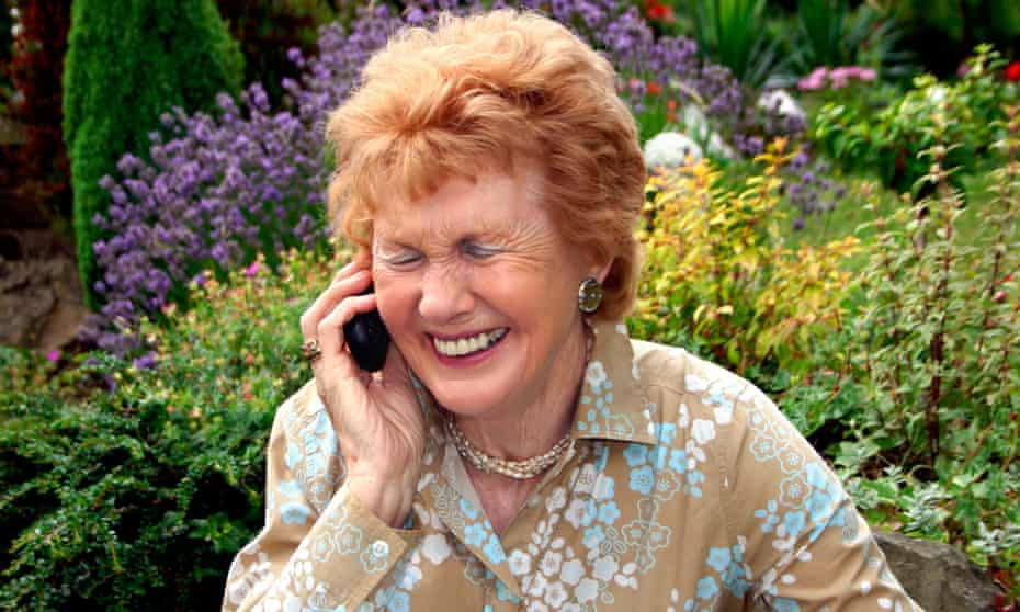 Older woman laughing on the phone