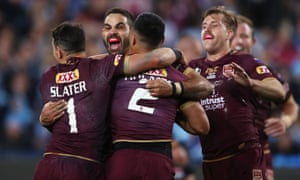 Queensland players celebrate a try