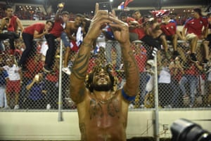 Panama's Roman Torres takes a picture of his team's fans celebrating after his winner against Costa Rica sealed a place at the World Cup.
