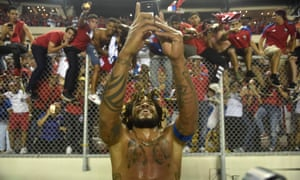Panama's Roman Torres takes a picture of his team's fans celebrating after he scored in the dramatic 2-1 home win over Costa Rica which mean World Cup qualification for the first time in the country's history.