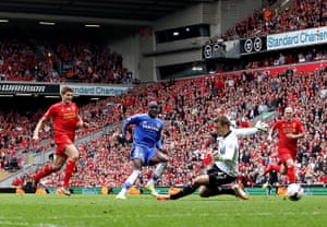 Demba Ba of Chelsea scores the opening goal of the game past Liverpool goalkeeper Simon Mignolet.