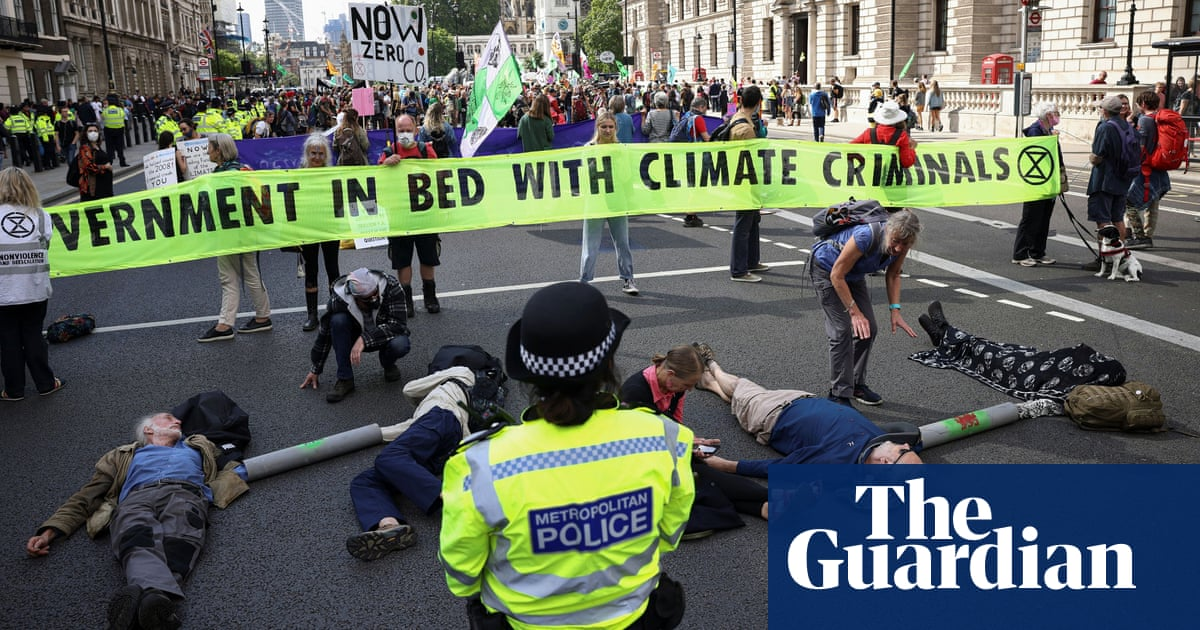 Extinction Rebellion blocks Whitehall in protest against HMRC and Barclays