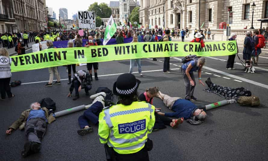 Extinction Rebellion activist protesting against HMRC's links with Barclays bank on Tuesday.