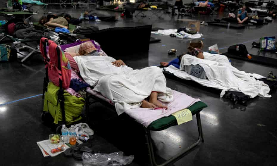 People sleep at a cooling shelter set up during an unprecedented heat wave in Portland on 27 June.