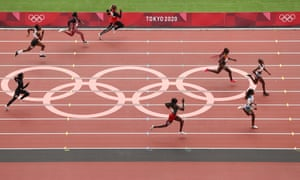 Natacha Ngoye Akamabi of Congo leads the field during the women's 100m preliminary round