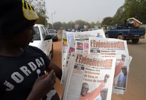 Newspaper headlines in Burkina Faso proclaim the victory of a new president-elect, Roch Marc Christian Kabore, earlier in December.
