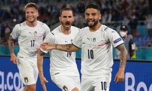 Italy's Lorenzo Insigne celebrates scoring their third goal with teammates.