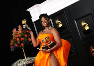 Megan Thee Stallion with her Grammys on the red carpet