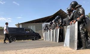 Law enforcement officers in Koi-Tash, where former the president Almazbek Atambayev's residence is located, on Thursday.