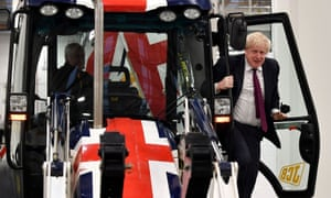 Boris Johnson exits the cab of a flag-themed JCB, during a general election campaign event in Uttoxeter.