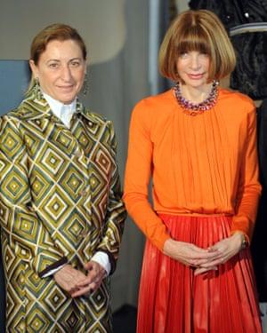 With Italian designer Miuccia Prada during a press conference announcing the Schiaparelli and Prada: Impossible Conversations exhibition in Milan, 2012.