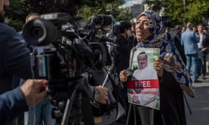 Tawakkol Karman holds a photo of Jamal Khashoggi, in front of the Saudi Arabian consulate. Turkish officials say Khashoggi was killed and his body smuggled out of the Saudi Arabian consulate.