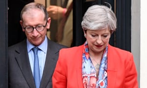 Theresa May leaves Conservative party headquarters with her husband Philip