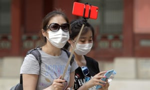 Tourists wear masks as a precaution against the MERS virus at the Gyeongbok palace in Seoul, South Korea.