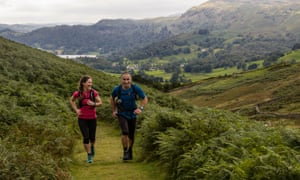 Ellie Ross and guide Mark Sandamas on a fell trail in the Lake District