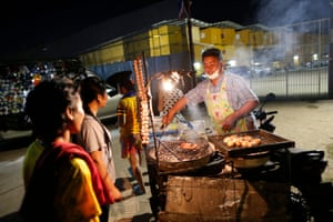 Migrant workers buy food for dinner
