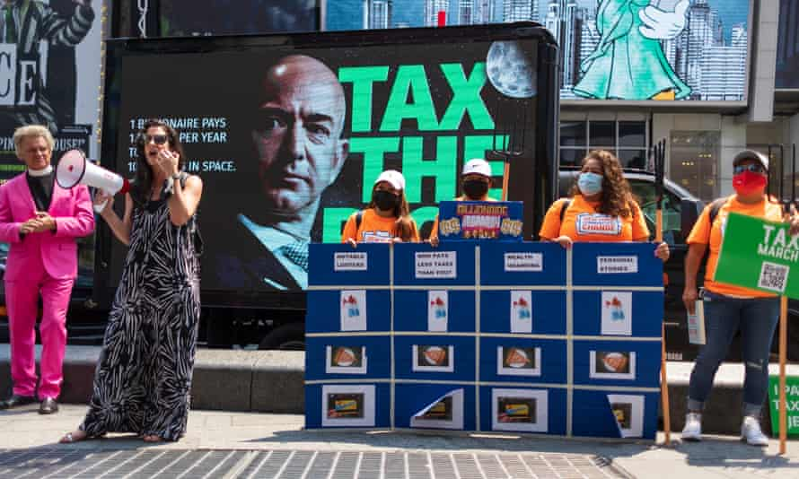 People take part in a small rally calling for a higher tax rate on the wealthiest Americans in Times Square in New York last month.