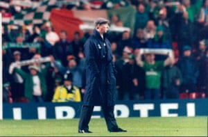 Jack Charlton walks past the Republic of Ireland fans singing on the Kop at Anfield..