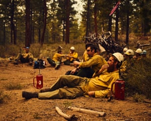 Firefighters relax after a controlled burn, sometimes used for forest management, in Redmond, Oregon