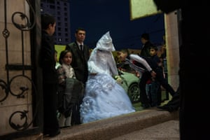 A bride waiting to enter the wedding hall. Women are not allowed to be seen on their wedding day by any man but their fiancé