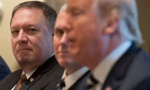 Mike Pompeo listens with vice-president Mike Pence as Donald Trump speaks.