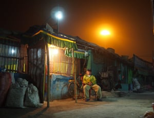 Michael Sheridan: Bodhgaya, India. Bodhgaya, Bihar, India: a restaurant owner gets some fresh air outside his smoky Tibetan cafe. This picture encapsulates the atmosphere of Bodhgaya's colourful alleyways, the village where Buddha reached enlightenment.