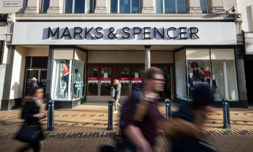 Shoppers walking past a branch of Marks & Spencer in Huddersfield