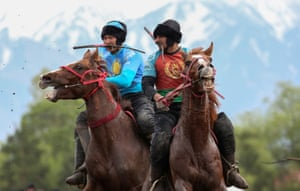 Almaty, KazakhstanHorsemen play Kokpar, a traditional game between two teams competing to throw a dummy of a goat into a scoring circle, during the first Asian Equestrian Championships.