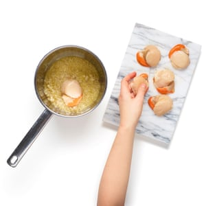 Sweat chopped shallots in butter until soft, then add the wine and reduce. Poach the scallops in the mix for a minute.