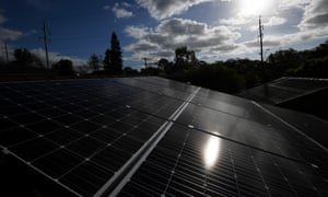 Solar panels are seen on the roof of a house in Sydney,