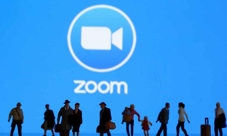 Small toy figures are seen in front of the Zoom logo