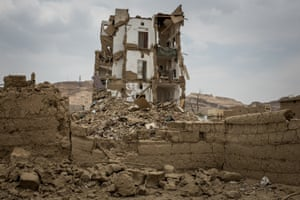 The city's Rahban district, after coalition airstrikes hit the neighbourhood