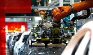 A robot adjusts a windscreen in a fully automated process on a model of the A-class production line of German car manufacturer Mercedes Benz at the Daimler factory in Rastatt.