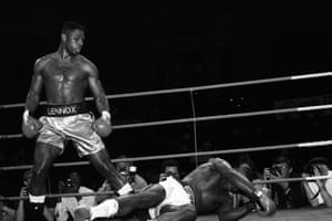 Lennox Lewis stands over Al Malcolm