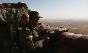 Soldiers wait at Mount Zertik as peshmerga forces attack Isis positions with howitzers in Mosul, Iraq, on 2 October.