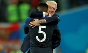 France coach Didier Deschamps celebrates with goalscorer Samuel Umtiti.