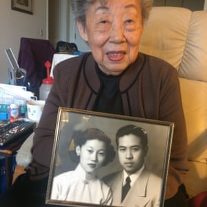 Roz Koo holds a photo of herself and her late husband Karlson.