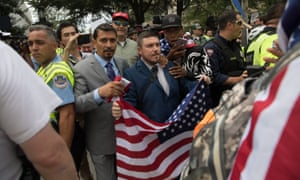 White supremacist Jason Kessler, center, and members of the alt-right march to the White House on the anniversary of last year's 'Unite the Right' rally in Washington DC.